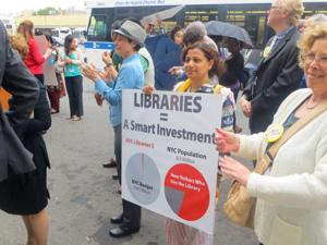 Rally held for Queens Library's city funding 1