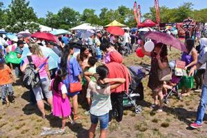 <p>Crowds gather near Meadow Lake during the annual Hong Kong dragon boat races in August. Crime is low at many large gatherings like this in Flushing Meadows Park.</p>