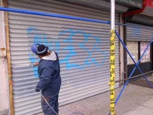 Scrubbing vandalism off Queens buildings 1