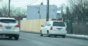 <p>The new wooden fence partially constructed at the vacant lot on Cross Bay Boulevard, just north of the Belt Parkway, where work on a strip mall will begin soon.</p>
