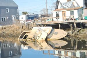 Sailors decry boats sinking into creek 2