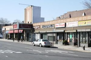 <p>Just weeks after the venerable Joe Abbracciamento Restaurant on the Rego Park-Middle Village border closed, the company planning to build apartments on the block it occupies has filed for a demolition permit to tear down the northern half of the structure. At least some of the other businesses there are not pleased.</p>