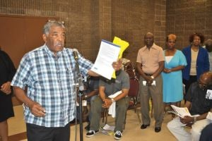 <p>Resident Charlie Crawford has questions for Department of Environmental Protection Commissioner Emily Lloyd on Monday. Lloyd, speaking at a town hall meeting, said long-awaited flood relief measures have begun in Southeast Queens.</p>