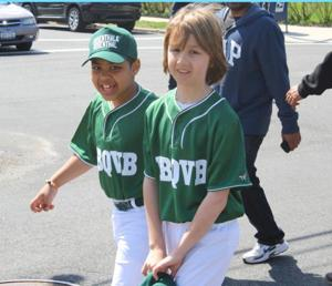 Little Leaguers have a ball during parade