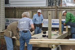 Jimmy Carter, Habitat for Humanity help Queens homeowner