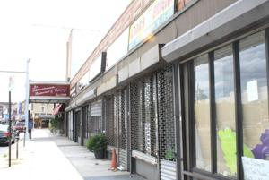 Businesses vacating Rego Park block 1