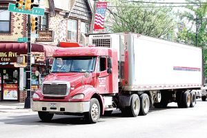 <p>An 18-wheeler on Flushing Avenue. COMET and elected officials are looking for more consistent and harsher enforcement for truck route violations. The DOT still doesn't explicitly label the Maspeth Bypass on its website maps.</p>