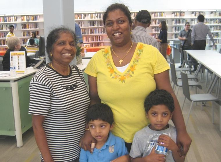 Three generations visit library 1