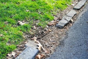 Avella slams city over broken curbs 2