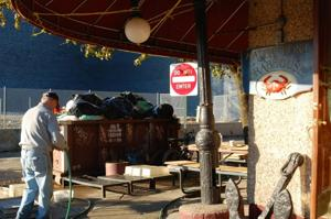 Hunters Point businesses cleanup damage from Hurricane Sandy 1