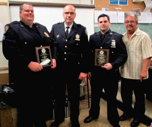 Cops honored for nabbing robbers 1