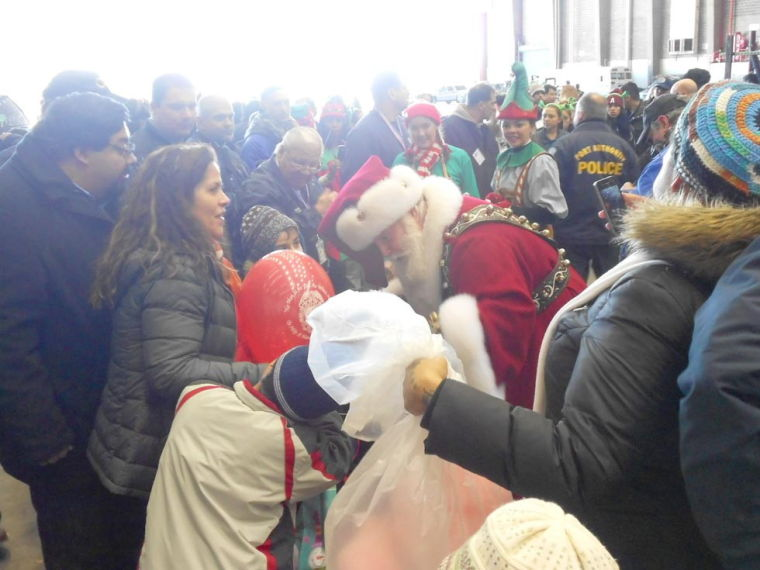 Santa visits disabled children at JFK Airport during Marine Corps event