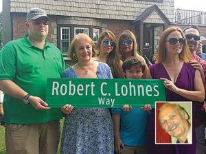 Beloved scout leader honored with sign 1