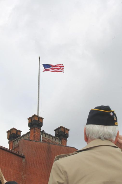 Stars and Stripes fly over clock tower 1