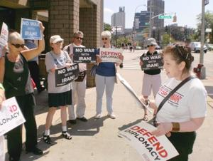 Group protests Meng's denial of Iran nuke deal 1