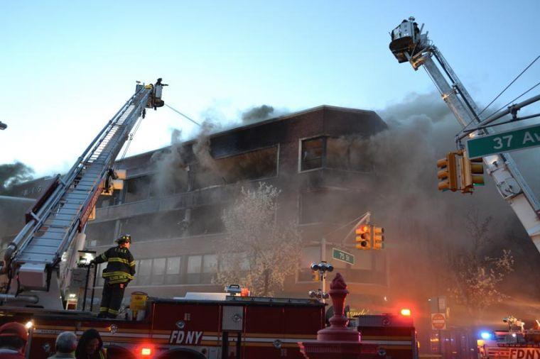 Flames rip through Jackson Heights 1