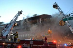 Flames rip through Jackson Heights 1