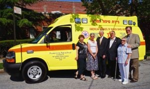 Temples merge and donate ambulance 1