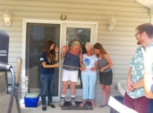 <p>Angela Calabro, left, join Lorraine Gresser, her mother Doris, and Sarah Johnson from AmeriCorps to cut the ribbon on the Gresser's newly repaired Roxbury home, that was damaged in Hurricane Sandy and left in limbo for over 18 months.</p>