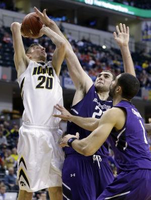 Northwestern extends Iowa's misery with first-round upset