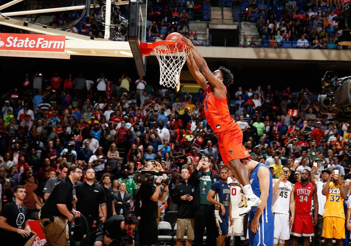 Clinton's Devan Douglas wins NCAA dunk contest, loses ...