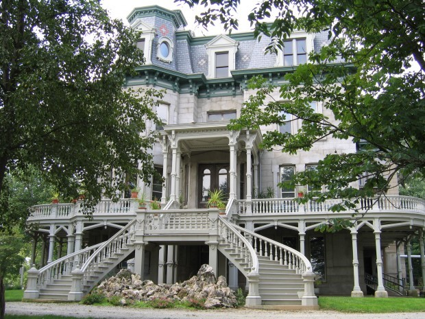 The exterior of the hegeler carus mansion features a horseshoe shaped