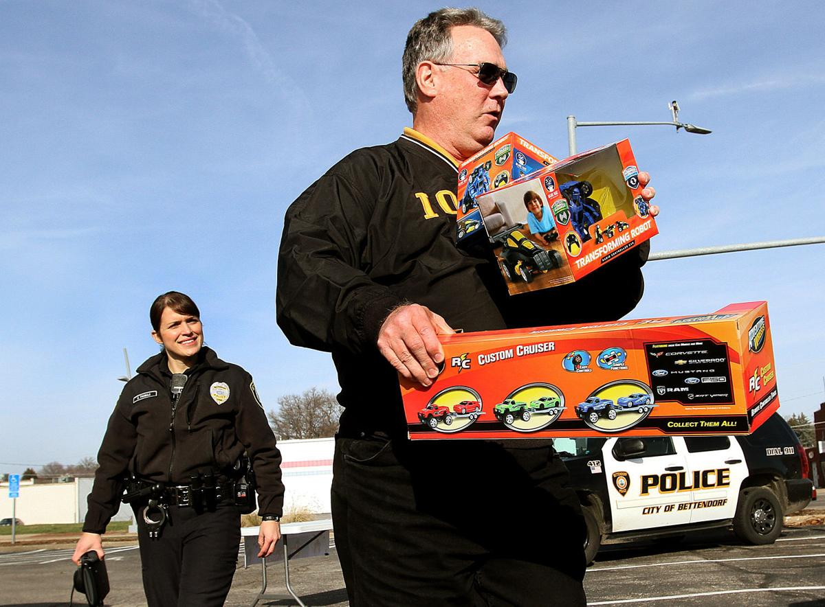 Police Toys For Tots 2017 : Toys flow in for bettendorf police effort government and