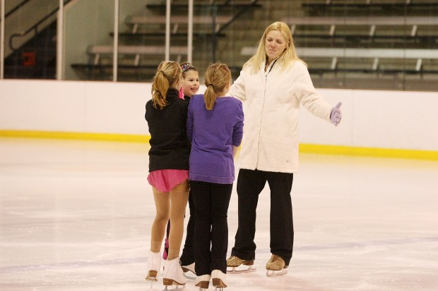 skating dispute turns icy father sues daughters 39 coach