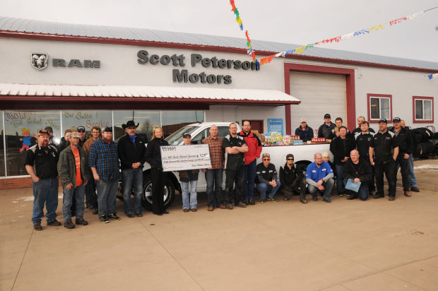 Auto Dealership Donates To Local Food Banks Belle