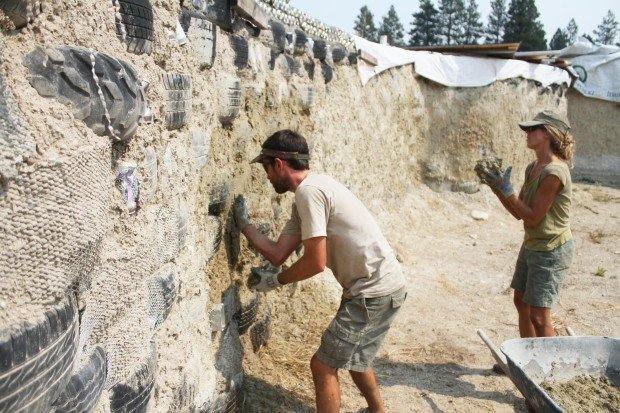 Earthship Construction Materials : Earthship home woman building new house out of recycled