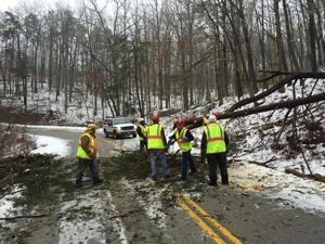 <p>Members of the Rhea County Rescue Squad's Spring City branch cut tress in Fentress County, Tenn., on Sunday along Highway 85. The rescue squad responded to a mutual aid call after counties on the plateau were hit hard by winter storms.</p><p></p>