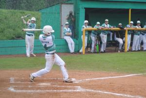 <p>Rhea County's Jordon Brown takes a swing in the 3rd inning against Stone Memorial Monday night. A Gabe Tyrell single allowed Brown to score the go-ahead and game-winning run after advancing to third base on a error and wild pitch.</p>