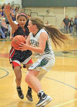 <p>Lady Pirate Kayla Tumlinson prepares for a jumper as a West Oso defender heads her way during Friday's home game against the Lady Bears.</p>
