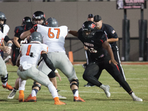<p>Albertville linebacker Micah Stallworth forces Grissom's Jaylin King to cut back to his left on this carry in Friday night's game. Stallworth pursued King across the field and made the tackle.</p>