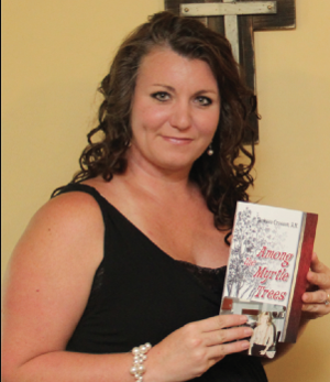 """<p>Vanessa Crosson holds a copy of her book """"Among the Myrtle Trees: Restoring Abandoned Faith"""" with a photo of her mother underneath.</p>"""