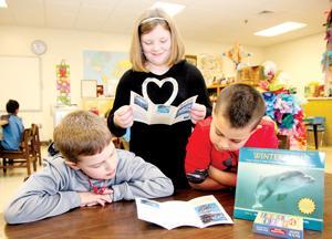 AES students make splash, help dolphin
