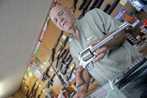 """<p class=""""p1""""><span class=""""s1"""">Seguin Gun & Pawn owner Richard Mergele displays a .44 magnum revolver on Thursday inside his store at 410 E Gonzales St. in Seguin. Mergele said he supports open carry legislation though he wouldn't do it himself.</span></p>"""