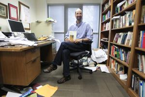 Front-page Sent-Trib pic of me in my messy office. By J.D. Poole.