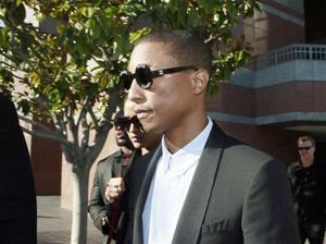 """<p>Pharrell Williams leaves Los Angeles Federal Court after testifying at trial in Los Angeles, Wednesday, March 4, 2015. The Grammy-winning singer Williams says he wasn't trying to copy the late Marvin Gaye's music for the hit song """"Blurred Lines,"""" but he was trying to evoke the feeling of late 1970s tunes. Williams is being sued by Gaye's children, who claim """"Blurred Lines"""" improperly copies their father's hit """"Got to Give it Up."""" Singer Robin Thicke and rapper T.I. are also defendants in the case. (AP Photo/Nick Ut)</p>"""