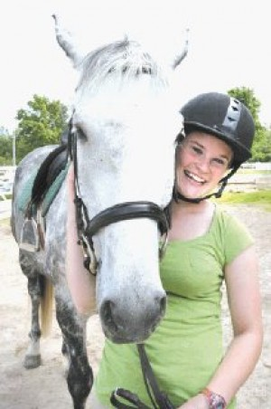 RIDING HIGH Teen's lifelong dream is working with horses