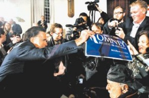 WHILE HE'S HOT Romney, with McCain, draws crowd in Peterborough