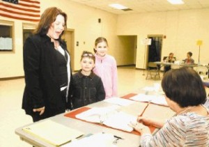 <p>Kristin Targett, left, of Keene checks in to vote with Pauline Dionne at the Keene Recreation Center this morning with her children, Victor, 7, and Olivia, 10, in tow. The recreation center covers Wards 1, 2 and 3.</p>