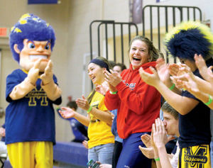 <p>Fans help Chip cheer on the Manistee Chippewas basketball team Monday in Manistee. The team eventually lost to the Mason County Central Spartans, who move on to face Benzie Central at 6 p.m. Wednesday, again in Manistee, during MHSAA Class B district quarterfinals.</p>