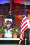 Ludington firefighter John Henderson gives the keynote address Friday honoring first responders at the Mason County Cost of Freedom Tribute traveling Vietnam Memorial.