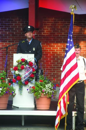 <p>Ludington firefighter John Henderson gives the keynote address Friday honoring first responders at the Mason County Cost of Freedom Tribute traveling Vietnam Memorial.</p>