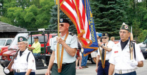 <p>The Baldwin honor guard leads Saturday's annual Ruby Creek Parade. The parade is part of the effort to raise money for the annual Disabled Veterans Hunt Sept. 20 and 21 at the Ruby Creek Tavern.</p>