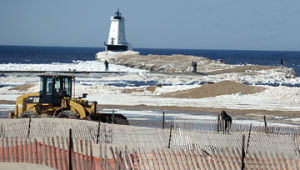 <p>The Ludington Department of Public Works continues to take down fencing at Stearns Park Beach Wednesday. The fence is put up to keep the sand on the beach during fall storms. The DPW is getting the park ready for the summer season.</p><p></p>