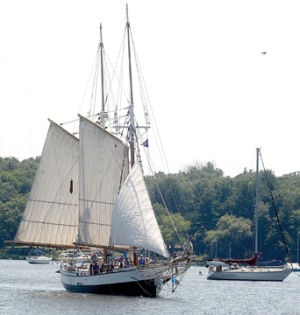 <p>The tall ship Madeline leaves the channel under wind power Monday followed by a number of curious boaters. People also watch and take pictures of the ship from the channel wall.</p><p></p>