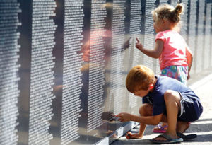 <p>Hayden and Noah Palmbos of Allendale get a closer look at the Traveling Vietnam Wall at Ludington City Park Thursday. The wall will be in city park through Sunday.</p>