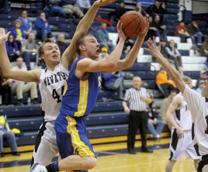 <p>Mason County Central's John Shafer slips inside of the Newaygo defense to score two of his 11 points Monday, March 10, 2014, in Petoskey in a MHSAA Class B regional semifinal.</p>